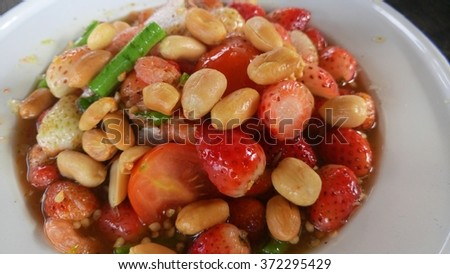 Spicy salad with strawberry - stock photo