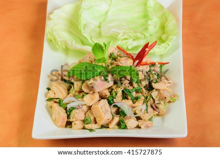 Spicy salmon salad in Thai style on white background