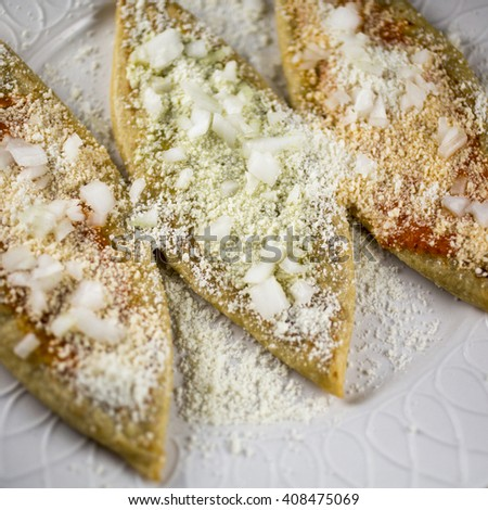 Spicy salsa and salsa verde Tlacoyos - stock photo
