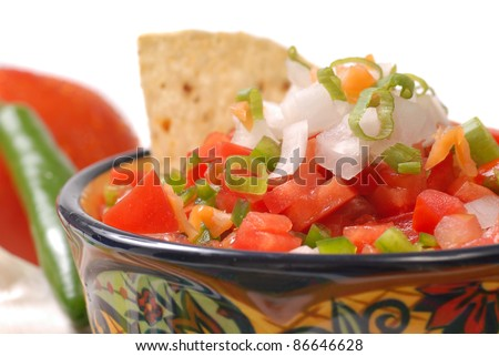 Spicy salsa with tortilla chips and ingredients - stock photo