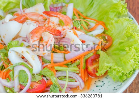 Spicy seafood salad, Thai food - stock photo
