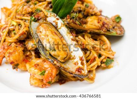 Spicy Seafood Spaghetti, Fusion Food, seafood. Selective focus, - stock photo