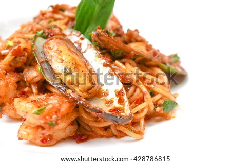Spicy Seafood Spaghetti, Fusion Food, Selective focus, Isolated on a white dish (slightly less warm tone) - stock photo