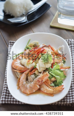 Spicy Shrimp and squid salad, Seafood Salad Thai call Yum Ta-Le the delicious Thai food. - stock photo