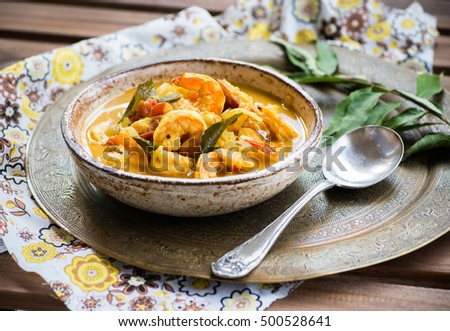 Spicy shrimp curry with coconut milk and chili in bowl, selective focus. Indian food, conju curry.