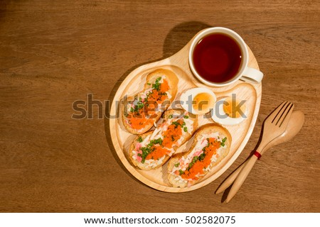 Spicy Shrimp eggs Baguette served with black coffee