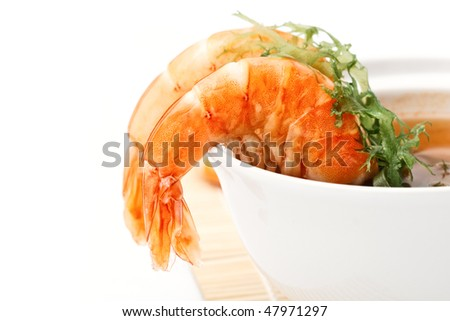Spicy Shrimp Soup on white background close-up - stock photo