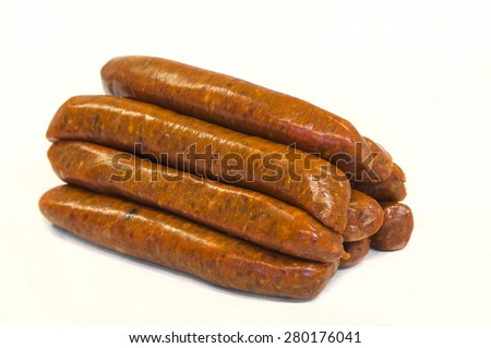 Spicy smoked red fresh sausages isolated - stock photo