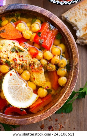 spicy soup with chicken and chickpeas - stock photo