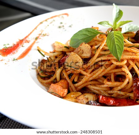 Spicy Spaghetti with Salmon - stock photo