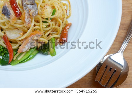 spicy spaghetti with salted fish - stock photo