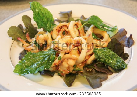 Spicy squids fried with chili and basil leaves