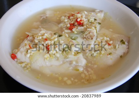 Spicy steamed fish fillet with chopped chillis