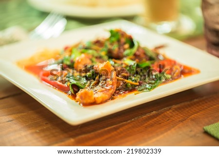 Spicy Stir Fried Fish in white plate - stock photo