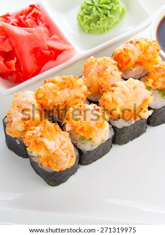 Spicy sushi roll with cinger and wasabi over white background - stock photo