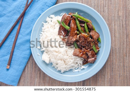 spicy thai beef and green bean entree with white rice - stock photo