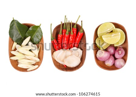 Spicy Thai food ingredients chili, lime,ginger,red onion,lemongrass isolated on white - stock photo