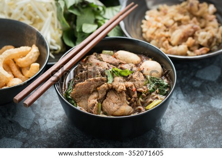 "spicy thai pork noodle, boat Noodle, ""Kuay Tiew Rua"" with pork rind and pork Crackling - stock photo"