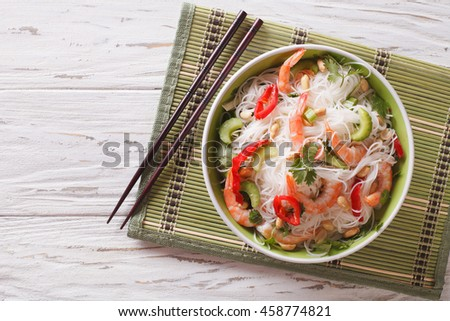 spicy Thai salad yam woon sen with seafood close up on a plate. horizontal view from above - stock photo