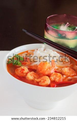 Spicy Thai shrimp soup - stock photo