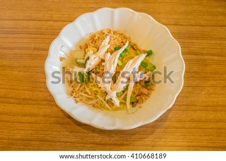 Spicy TOM YAM chicken noodle with lemongrass, chilly pasted and lime juice - stock photo