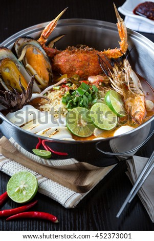spicy Tom yam seafoods noodle soup /styling