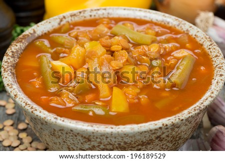Spicy tomato soup with lentils and vegetables, close-up, horizontal - stock photo