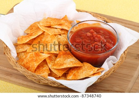 Spicy tortilla chips and salsa in a basket