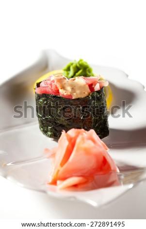 Spicy Tuna Gunkan Sushi. Garnished with Ginger and Wasabi - stock photo