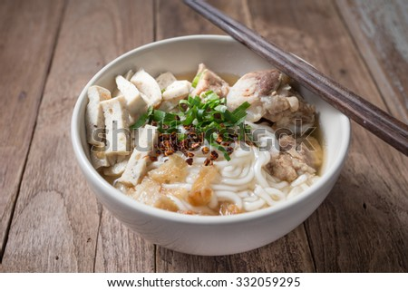 Spicy vietnamese Noodle Soup with  wooden chopsticks - stock photo