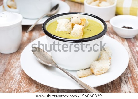 spicy zucchini soup with croutons in a cups - stock photo