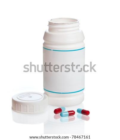 Spilled capsules from white prescription bottle. Isolated on white background - stock photo