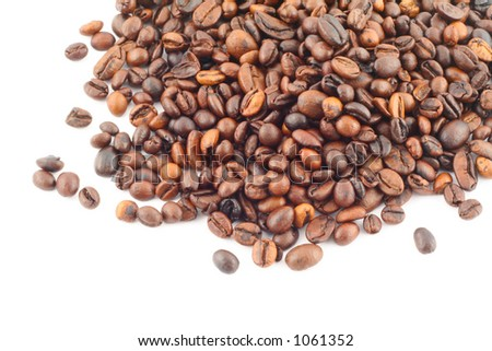 spilled coffe beans on white - stock photo