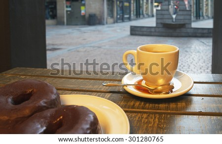 Spilled coffee in street cafe. - stock photo