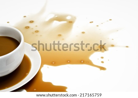 Spilled Coffee on White Desk - stock photo
