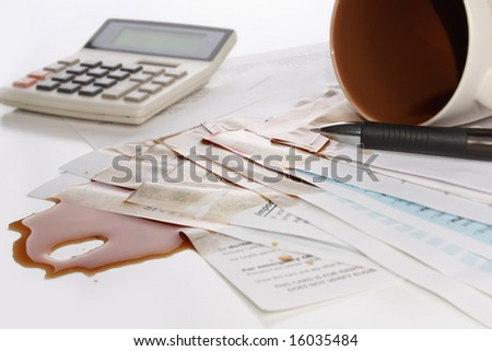 Spilled coffee over documents - stock photo