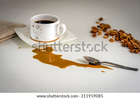 Spilled coffee stain on the table during the breakfast. - stock photo