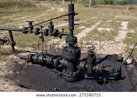 Spilled crude oil around oil field. Oil and Gas Industry - stock photo
