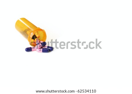 Spilled Generic Antibiotic Capsules from Prescription Bottle - stock photo
