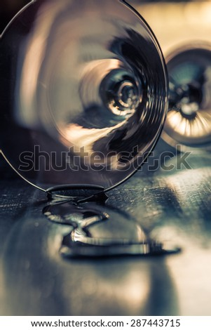 spilled glass of martini closeup on a dark background - stock photo