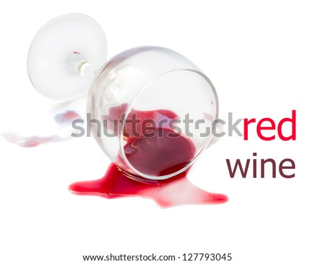 spilled glass of red wine isolated on white background - stock photo