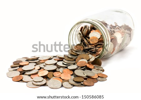 Spilled jar of coins isolated on white background - stock photo