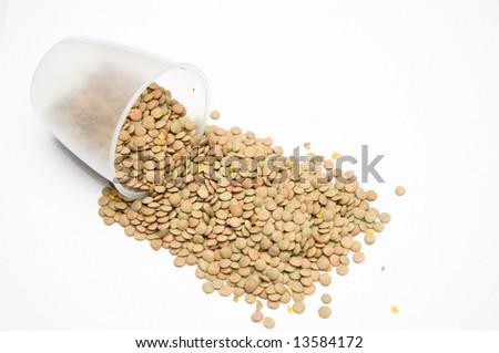 Spilled Lentil Beans on Isolated White Background - stock photo