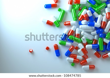 spilled pills, a top view of the light source from above - stock photo