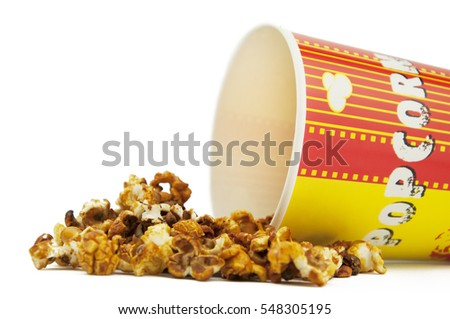 Spilled popcorn with a paper cup isolated on white background