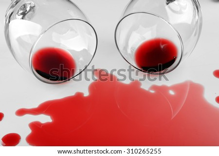 Spilled wine from glasses on white background - stock photo