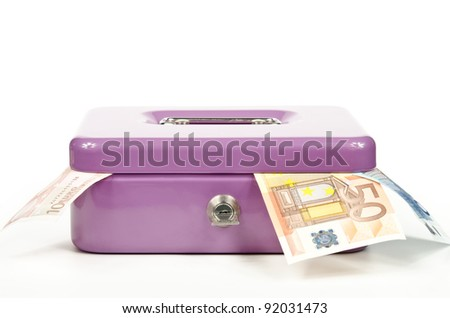 spilling cash box - stock photo