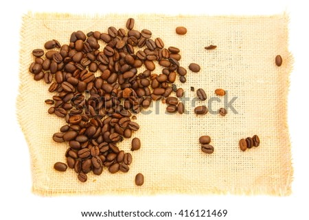 spilling coffee bean on burlap . white background
