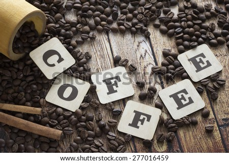 spilling coffee, cinnamon and letters - stock photo