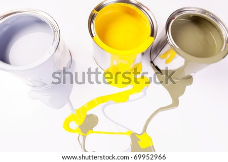 Spilling paint on white paper board - stock photo